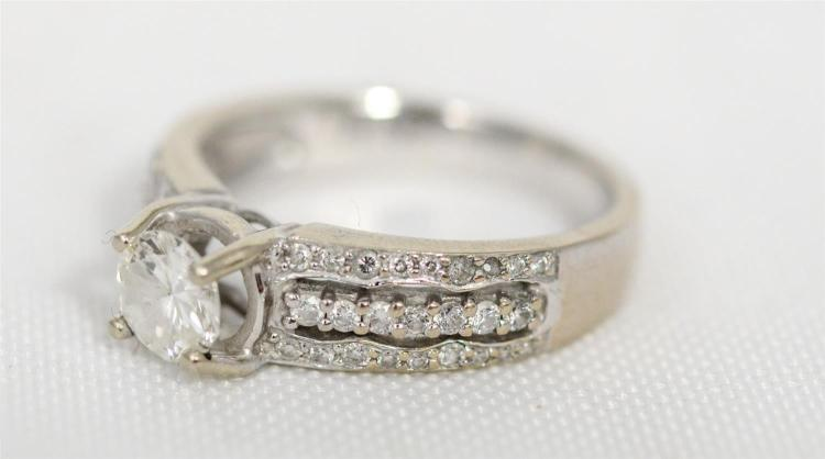 Unmarked white metal diamond engagement band, 50 pt center diamond, each shoulder with a triple row of 50 total round brilliant cut...