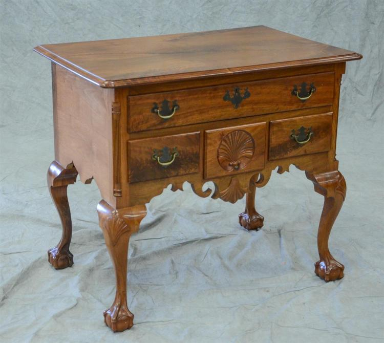 Walnut Chippendale style lowboy, molded and notched top over a base with shell carved scalloped apron, shell carved drawer, shell ca...