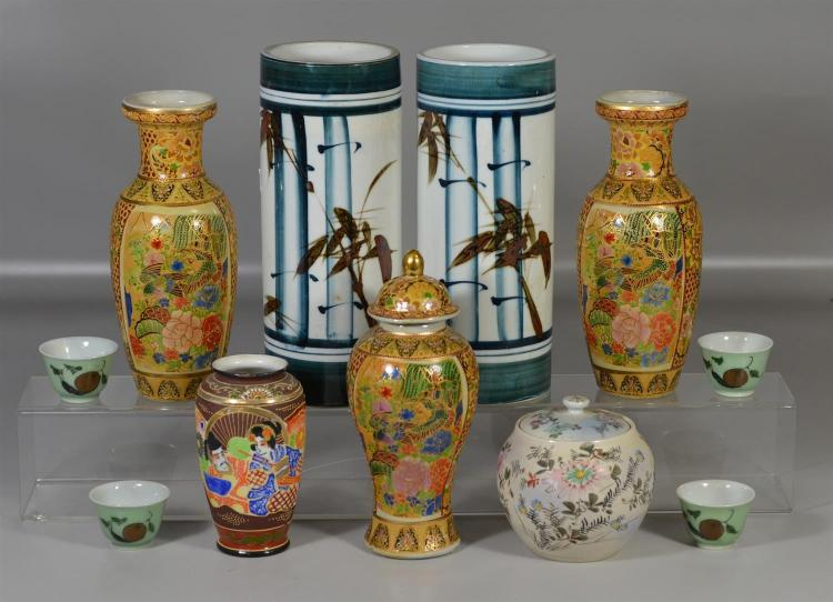 (11) pieces of Asian porcelain to include a pair of hat stands, pair of vases, covered vase, 4 cups with calligraphy, covered jar an...