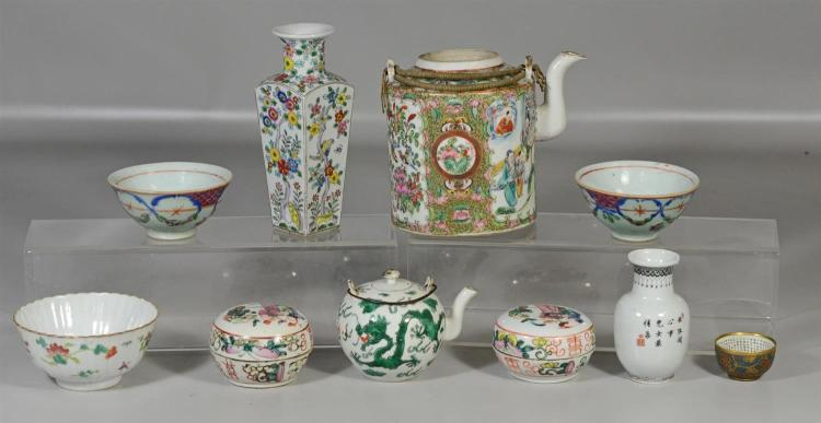 10 Pieces of Asian porcelain to include a Famille Vert teapot with no lid, 2 covered cosmetic boxes, 3 bowls, 2 vases, green dragon ...