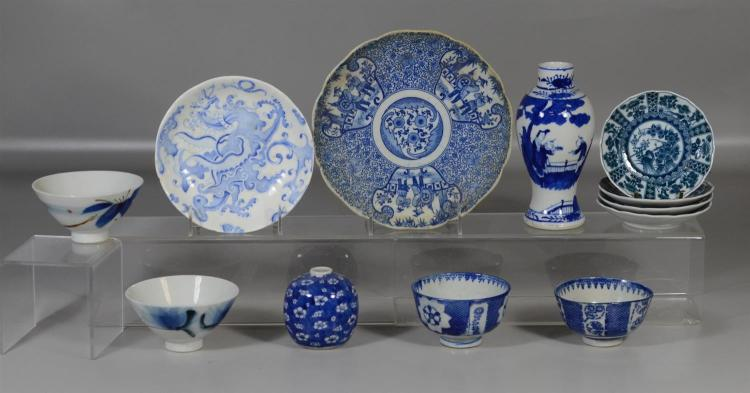 12 Pieces blue and white Asian porcelain to include 2 plates, set of 4 small plates, 2 vases and 4 bowls, tallest 7