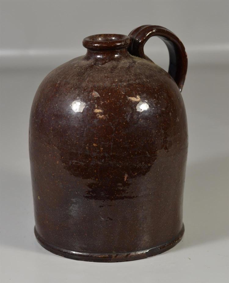 Brown glazed redware jug, minor chips to base, 10