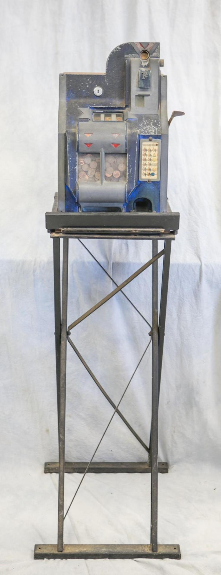 Mills 1 cent Bell Fruit slot machine, oak case, original paint, somewhat worn, working condition, on original base, with key, machin...
