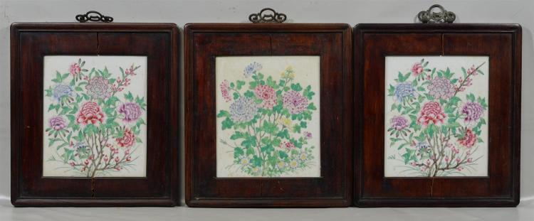 (3) Chinese hardwood framed porcelain tiles, each time painted with a floral design, 16 1/2