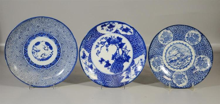 Three (3) Japanese blue and white porcelain chargers, largest 11