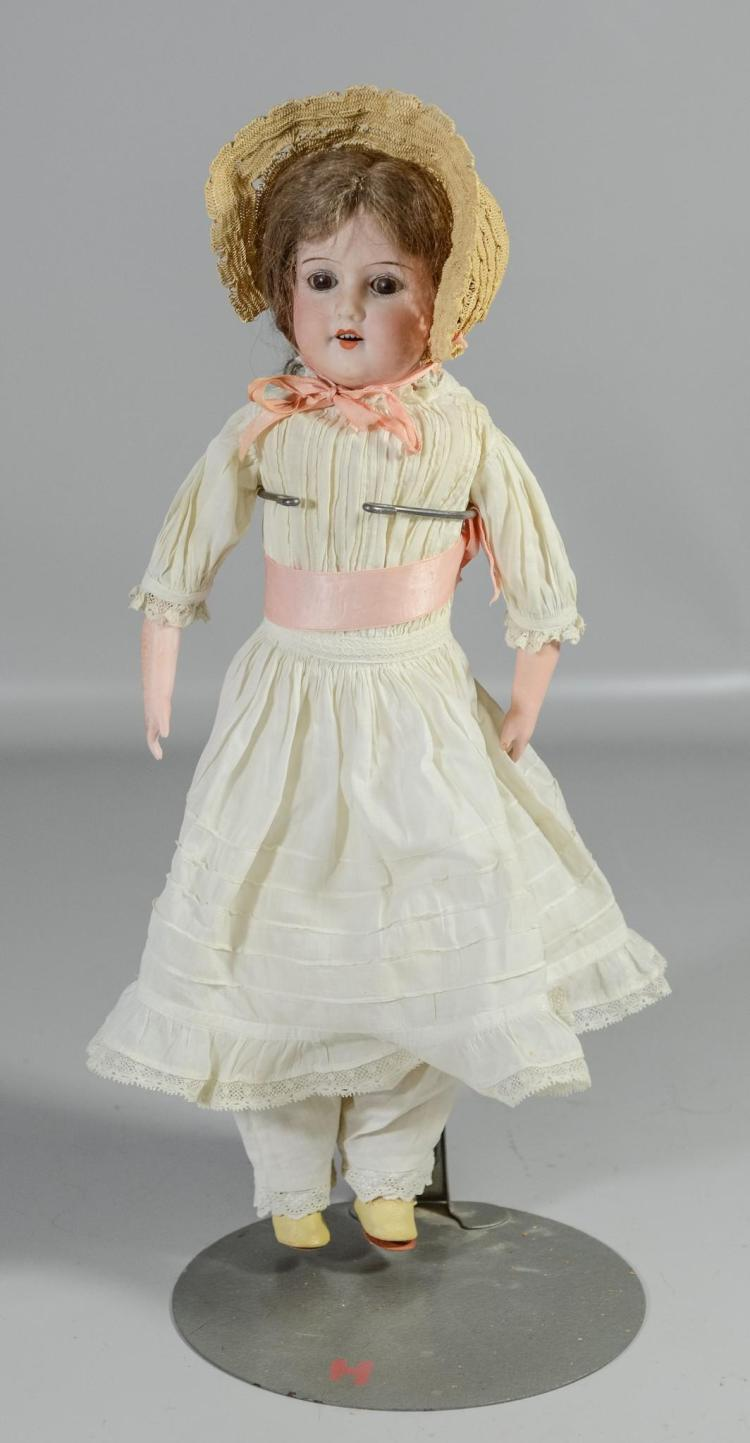 Armand Marseilles German bisque head doll, sleep eyes, open mouth, 4 teeth, jointed leather body, bisque hands & feet, marked on bac...