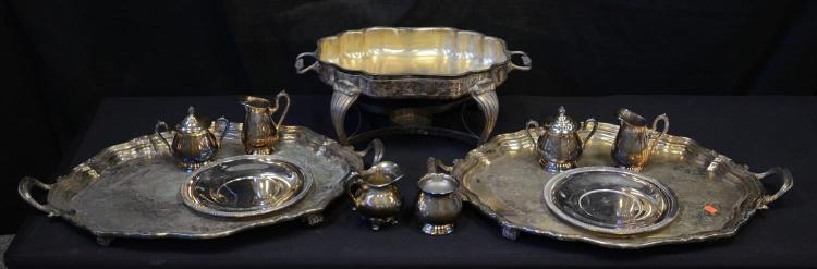 (2) oval scalloped plated silver trays, and oval open chafing dish, 2 round plated plates, and 3 pair of plated silver creamer pitch...