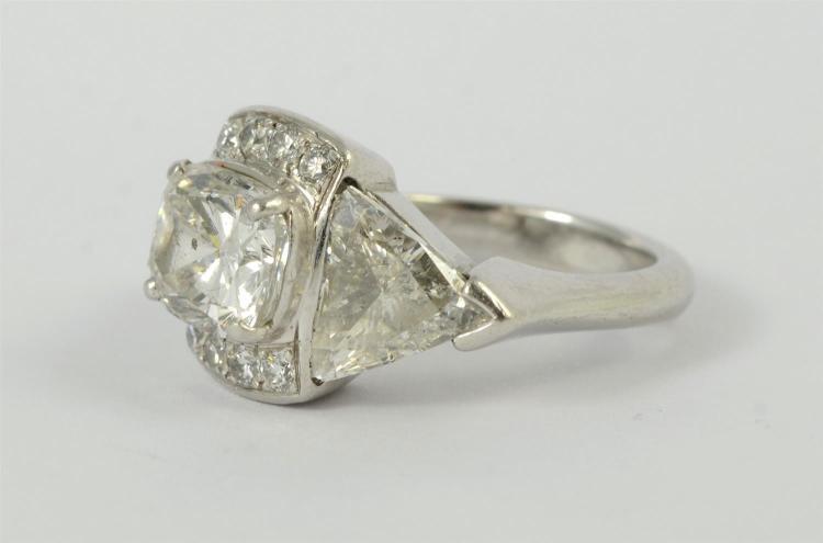 Platinum ladies 6 carat diamond engagement ring, center set with 3