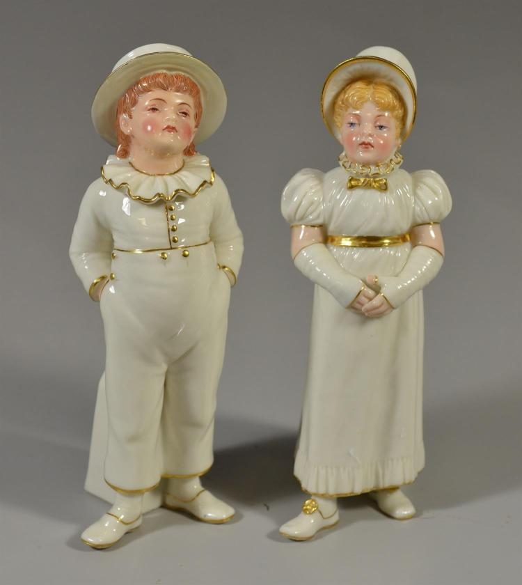 Pair of Royal Worcester figurines of young boy and a girl, 7