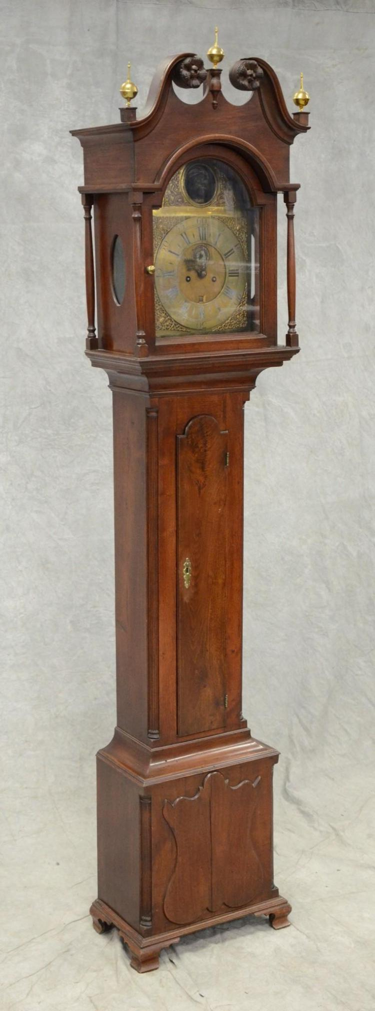 Walnut PA Chippendale tall case clock, containing a brass dial English 8 day movement, with an articulated nodding blackamoor head i...
