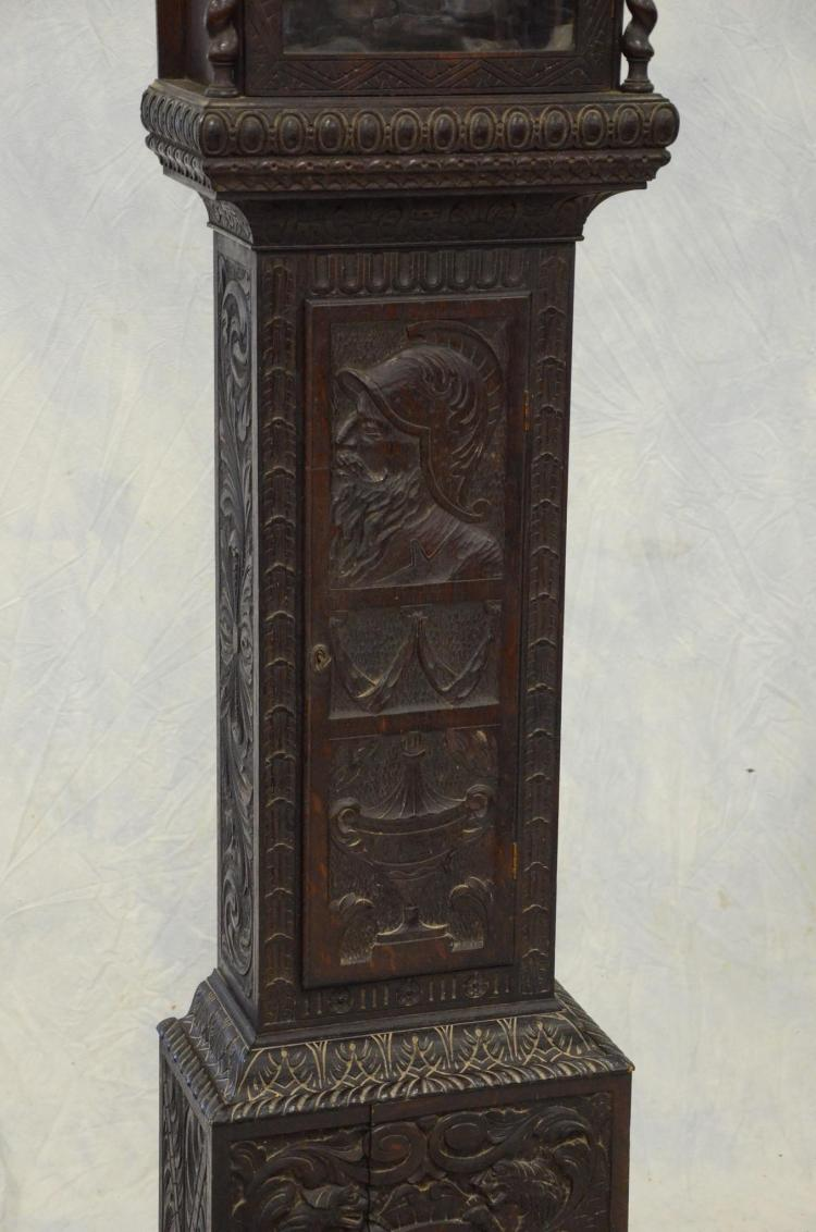 Carved oak tall case clock with swedish themed relief carvin