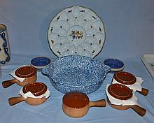 Italian deviled egg plate, blue spongeware basin, five French onion crocks, and two low stoneware bowls.