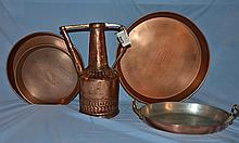 12 pieces of copper, including a ewer, a baking dish, and 10 pans by Guy Wolff.