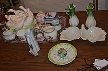 Porcelain, including 4 covered boxes, creamer, sugar, dog figurine, small bell, 2 cruets, Havilland pitcher, duck planter, a leaf di...