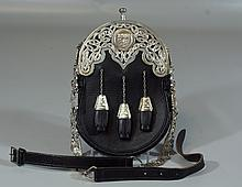 Scottish  leather and silver sporran, engraved center with