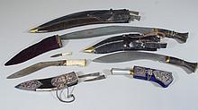 (5) Ghurka Kukri, various handles, brass & silvered fittings, leather scabbards, each with 2 small dirks, one missing kukri, longest...