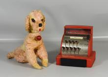 Two vintage toys to include a Tom Thumb cash register with cracked glass and a well loved stuffed dog, tallest 12