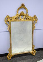 Italian Carved and gilt wood wall mirror, with losses mostly on edges, 58