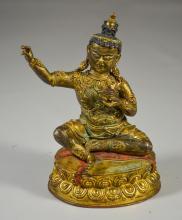 Tibetan gilt bronze figure holding a kapala cup, with sealed base, 7 1/2