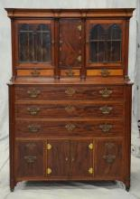 Mahogany & figurd maple  (2) piece New England Sheraton  library cabinet, c 1810-20, top section with a center door concealing a fit...