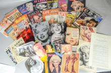 Marilyn Monroe memorabilia lot, including 2 DVDs, 6 books, calendars, large quantity, Life & other magazines, together with small qu...