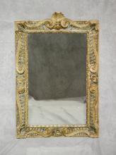 Carved and gilt finished Continental wall mirror, 19th c, 41 1/4