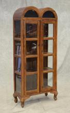 Asian style wood curio cabinet, 2 glass paned doors glass arched top, 4 shelves, 73-1/2