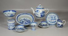 11 Pieces of Chinese Canton blue and white porcelain to include a reticulated fruit basket, teapot, covered jar, stem cup, 2 cups an...
