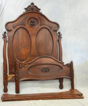 Carved walnut Victorian bed with double oval panel headboard with ladies head crest, c 1860-70, 88