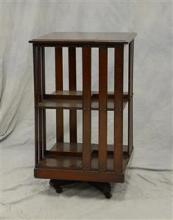 Victorian 2-tier Mahogany revolving bookcase, mahogany with two tiers, each shelf with 4 separators, rolling base, 32
