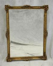 French Style gilt carved hanging wall mirror, gilt painted composition frame, beveled glass mirror, light wear, crack in corner of m...