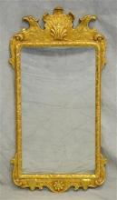 Kittinger Colonial Williamsburg gilt carved hanging wall mirror, gilt carved frame with eagles heads and shell motif on crest, burnt...