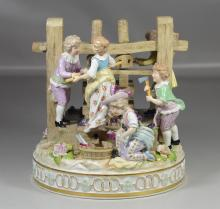 Carl Thieme, Saxony porcelain figural group of children playing atop wine press, some restorations and losses, marked with blue unde...