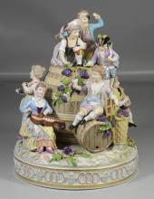 Carl Thieme, Saxony porcelain figural group of children playing atop wine kegs, several with instruments, some restorations and loss...