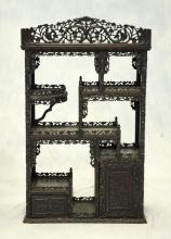 Carved rosewood Asian etagere, drawer & cupboard door at base, 58