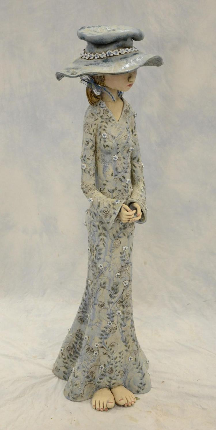2 piece pottery figure of woman with 12 separate flowers in for Separation decorative entre 2 pieces