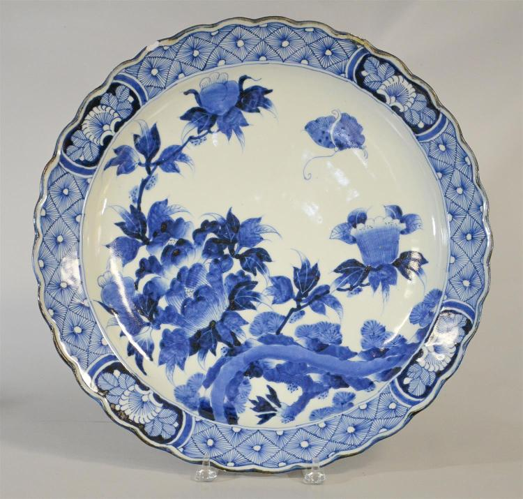 Japanese blue & white charger with peonies and butterflies, chip and old repair to border, 18