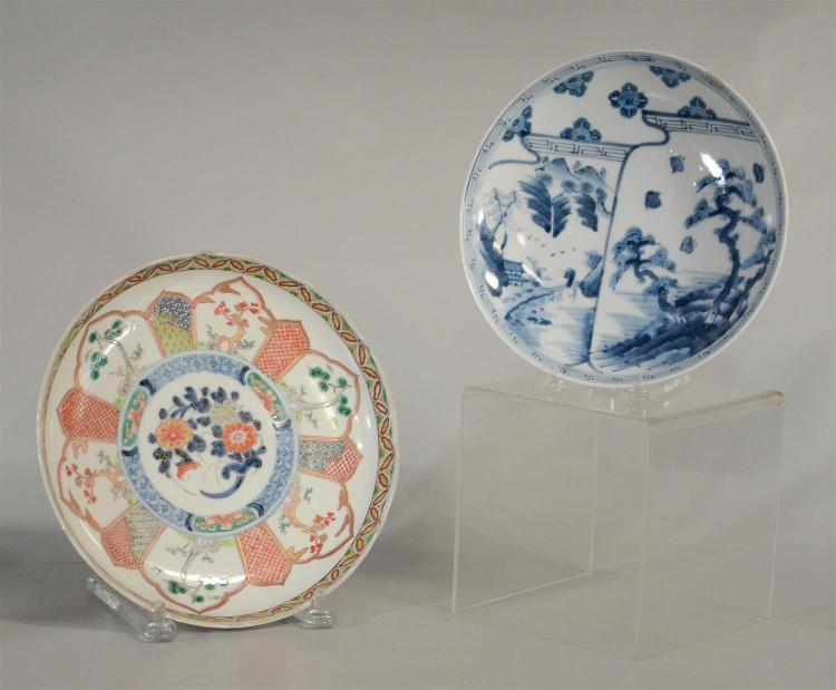 2 Japanese Imari plates, 1 multicolor with Lotus border, the other blue and white, largest 9-1/2