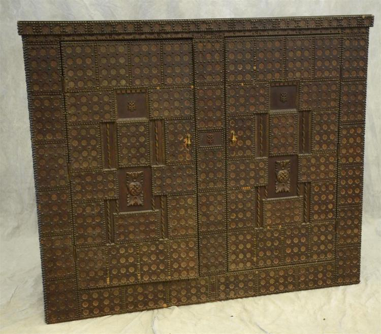 Spanish style 2 door cabinet with star punched and brass tack design overall, 20th c, 70