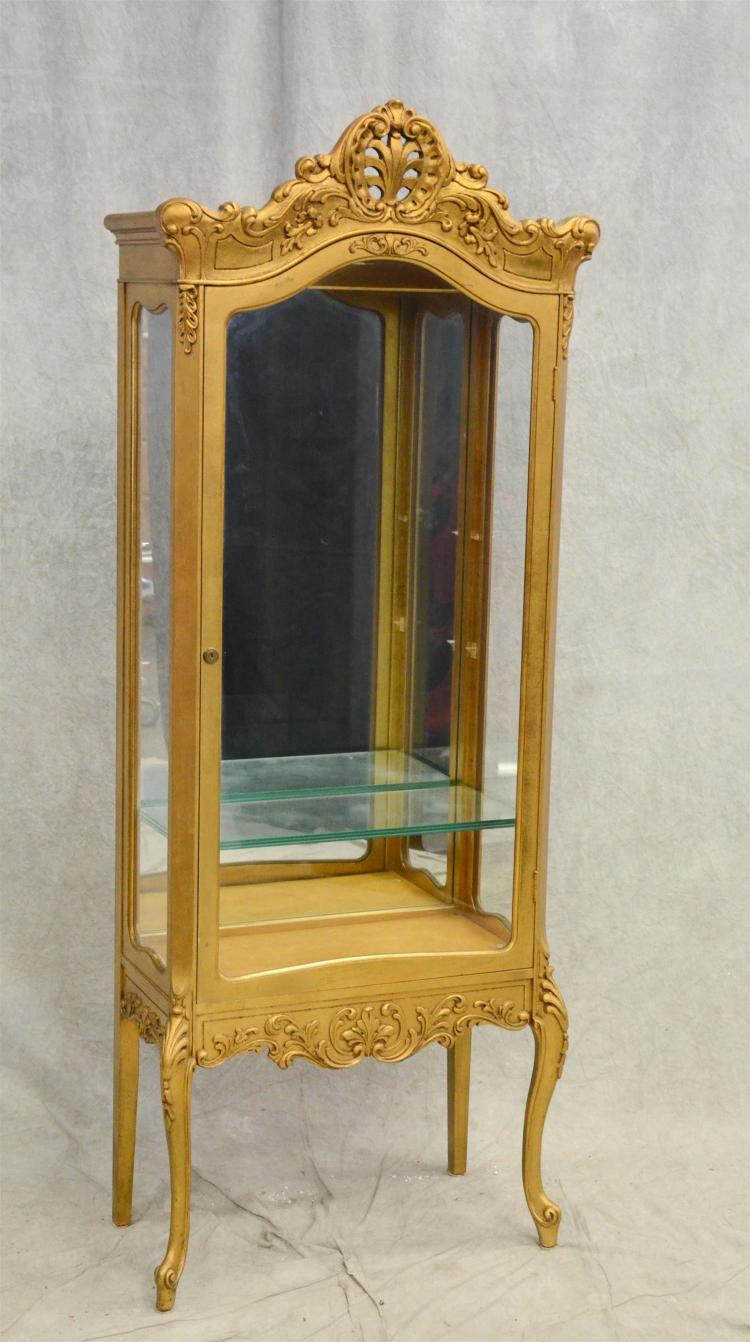Louis XV style gilt carved china cabinet, gilt carved frame, mirrored back, single glass door, glass shelves, 71