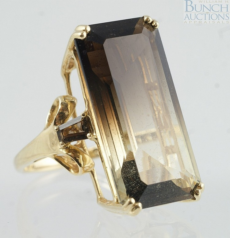 14K YG ladies ring with emerald cut stone shaded from a pale yellow to a pale brown, 34 x 12mm, size 5 1/2, 4
