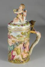 Rudolstadt 'Capo-di-Monte' type tankard, E. Bohne, early 20th C, molded in relief with a Bacchanalian scene,  the scroll handle with.