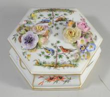 Wallendorf-type porcelain hexagonal covered box, 20th C, the sides and top decorated with floral sprays, insects and birds, with flo...