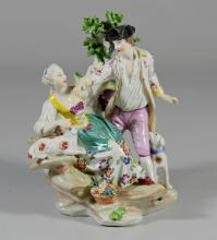 Royal Vienna type group of a Gentleman and a Lady, late 19th  C, each in 18th C Costume, the lady seated on a rocky plinth beside a...