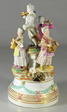 Royal Vienna-type group, of a quartet, c 1900, each figure in 18th C costume standing on plinths on a round socle base with impresse...