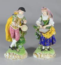Pair of Derby figures of musicians, circa 1780-1784, modeled as a lady with a zither and man with tambourine, with iron-red script c...