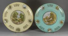 Pair of Hutschenreuther porcelain pictorial chargers, 20th C, each having a rural landscape medallion surrounded by landscape and wi...