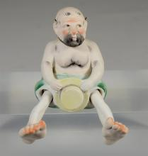Japanese painted bisque figure of a 'Nodding Pagoda', 20th C, H: 4