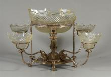 Plated silver epergne, unsigned, with 4 removable arms, cut glass center basket and small inserts with damage, the frame 9-3/4