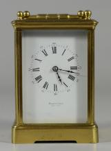 French carriage clock, time and hour/half hour strike, white enameled dial marked Hamann & Koch, New York, Importers/Jewelers, 6 1/2...
